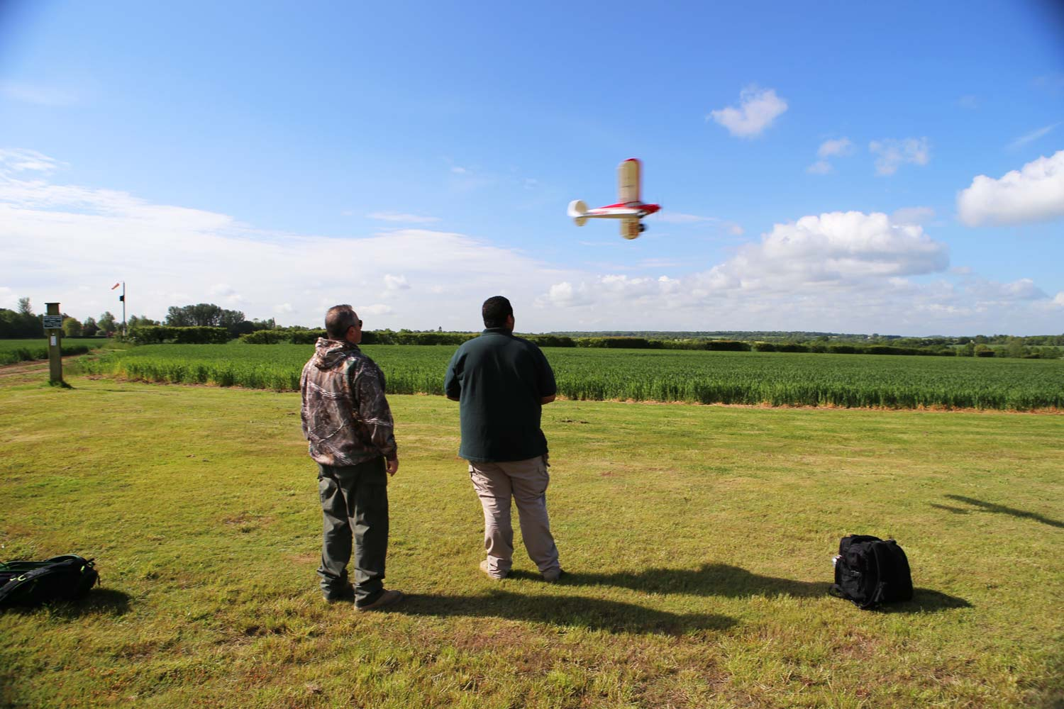 Customers flying a model aircraft around Pete's Airgun Farm in Essex